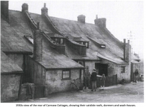 1930s view of the rear of Carnsew Cottages, showing their catslide roofs, dormers and wash-houses