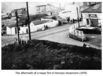 The aftermath of a major fire in Harveys showroom c1970