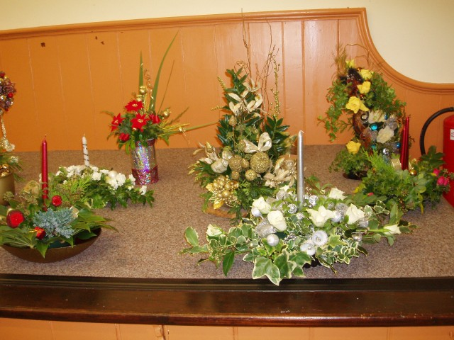 Tableau of Christmas Flower Arrangements